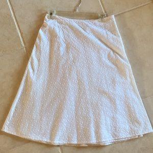white eyelet A-line skirt